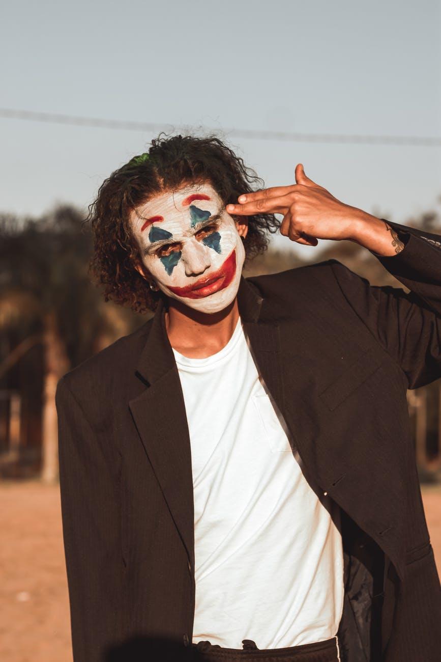 man wearing the joker makeup