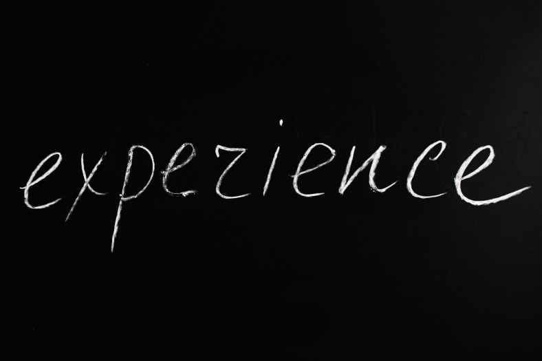 experience lettering text on black background