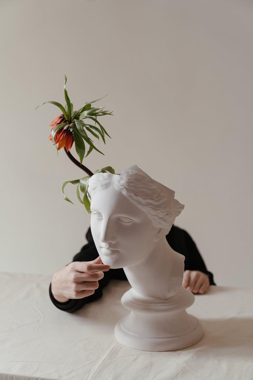 white rose on womans face ceramic figurine