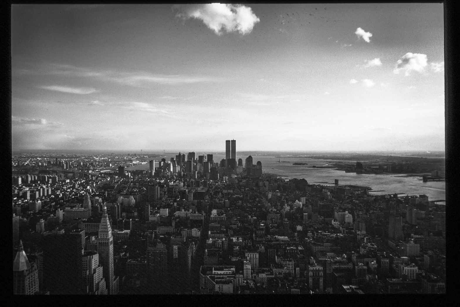 monochrome photo of city during daytime